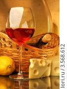 Купить «Композиция с бокалом красного вина, корзиной, лимоном и сыром», фото № 3568612, снято 14 мая 2012 г. (c) Виктор Топорков / Фотобанк Лори