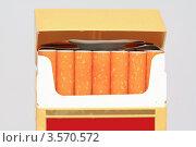 Купить «Открытая пачка с сигаретами на сером фоне», фото № 3570572, снято 8 марта 2012 г. (c) Сергей Яковлев / Фотобанк Лори