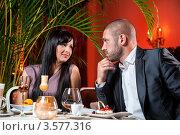 Купить «Мужчина и женщина за столиком в ресторане», фото № 3577316, снято 24 мая 2012 г. (c) Alexander Tihonovs / Фотобанк Лори