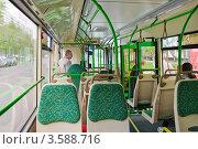 Купить «Пассажиры в салоне нового автобуса ЛиАЗ - 5292.21», эксклюзивное фото № 3588716, снято 5 мая 2012 г. (c) Алёшина Оксана / Фотобанк Лори