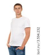 Купить «Портрет мужчины в белой футболке и джинсах, белый фон», фото № 3594232, снято 8 мая 2012 г. (c) Руслан Кудрин / Фотобанк Лори