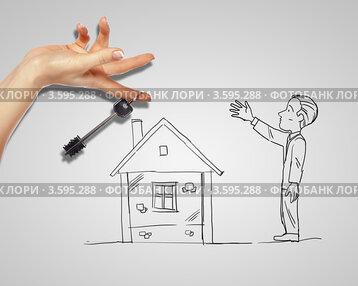 Купить «Рука протягивает человеку ключ от квартиры», иллюстрация № 3595288 (c) Sergey Nivens / Фотобанк Лори