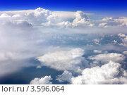 Купить «Вид из самолёта на белые кучевые облака и синее небо», фото № 3596064, снято 31 мая 2012 г. (c) Vitas / Фотобанк Лори