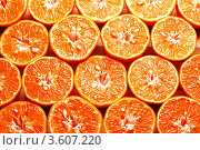 Купить «Половинки мандаринов, фон», фото № 3607220, снято 26 февраля 2008 г. (c) Francesco Perre / Фотобанк Лори