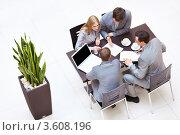 Купить «Четверо деловых людей работают за одним столом», фото № 3608196, снято 6 апреля 2012 г. (c) Raev Denis / Фотобанк Лори