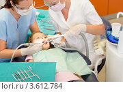 Купить «Стоматолог лечит девочке зубы», фото № 3612784, снято 29 апреля 2012 г. (c) CandyBox Images / Фотобанк Лори