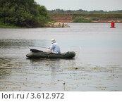 Купить «Рыбак в резиновой лодке с удочками и подсачеком», фото № 3612972, снято 15 июня 2012 г. (c) Алексей Пантелеев / Фотобанк Лори