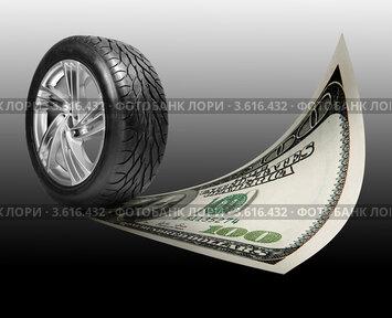 Купить «Автомобильное колесо и стодолларовая купюра», фото № 3616432, снято 27 февраля 2009 г. (c) Эдуард Стельмах / Фотобанк Лори