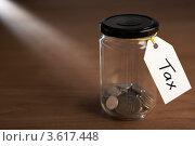 "Купить «Монетки в банке с ярлыком ""НДС""», фото № 3617448, снято 24 августа 2011 г. (c) Monkey Business Images / Фотобанк Лори"