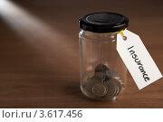 """Купить «Монетки в банке с ярлыком """"Уверенность""""», фото № 3617456, снято 24 августа 2011 г. (c) Monkey Business Images / Фотобанк Лори"""