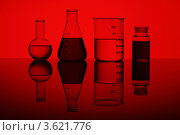 Купить «Колбы с растворами на красном фоне», фото № 3621776, снято 14 марта 2012 г. (c) Sergey Nivens / Фотобанк Лори