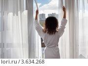 Купить «Женщина в белом халате занавешивает шторы на окнах», фото № 3634268, снято 2 мая 2011 г. (c) Losevsky Pavel / Фотобанк Лори