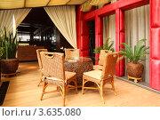 Купить «Стол и плетеные стулья в ресторане», фото № 3635080, снято 15 мая 2011 г. (c) Losevsky Pavel / Фотобанк Лори