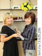Купить «Две улыбающиеся женщины выбирают цвета лака для маникюра», фото № 3635296, снято 18 мая 2011 г. (c) Losevsky Pavel / Фотобанк Лори