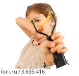 Купить «Девочка стреляет из рогатки, белый фон», фото № 3635416, снято 1 апреля 2011 г. (c) Losevsky Pavel / Фотобанк Лори