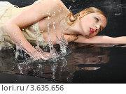 Купить «Мокрая девушка в платье с корсетом лежит на полу в брызгах воды», фото № 3635656, снято 2 апреля 2011 г. (c) Losevsky Pavel / Фотобанк Лори