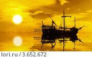 Купить «Силуэт парусного корабля на фоне заката с отражением в воде», видеоролик № 3652672, снято 7 июля 2012 г. (c) Beerkoff / Фотобанк Лори