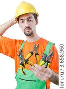Купить «Задумчивый рабочий держит непонятные инструменты в руке», фото № 3658960, снято 3 апреля 2012 г. (c) Elnur / Фотобанк Лори