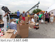 Пункт сбора гуманитарной помощи для пострадавших от наводнения на Кубани (2012 год). Редакционное фото, фотограф Наталья Волкова / Фотобанк Лори