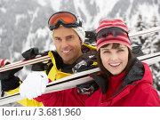 Купить «Парень и девушка держат на плечах горные лыжи», фото № 3681960, снято 25 января 2012 г. (c) Monkey Business Images / Фотобанк Лори