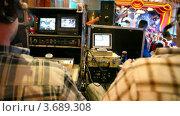 Купить «Режиссеры наблюдают за ходом концерта на мониторах», видеоролик № 3689308, снято 13 августа 2010 г. (c) Losevsky Pavel / Фотобанк Лори