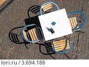 Купить «Столик в летнем кафе», фото № 3694188, снято 30 июня 2012 г. (c) Константин Лабунский / Фотобанк Лори