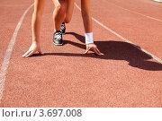 Купить «Спортсмен-бегун на низком старте на беговой дорожке», фото № 3697008, снято 25 мая 2012 г. (c) Великова Ирина Николаевна / Фотобанк Лори