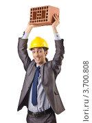 Купить «Строитель держит кирпич над головой», фото № 3700808, снято 22 мая 2012 г. (c) Elnur / Фотобанк Лори