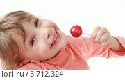 Купить «Улыбающаяся девочка с леденцом», видеоролик № 3712324, снято 12 декабря 2010 г. (c) Losevsky Pavel / Фотобанк Лори