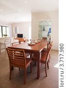 Купить «Интерьер гостиной с обеденным столом посередине комнаты», фото № 3717980, снято 12 мая 2012 г. (c) Кропотов Лев / Фотобанк Лори