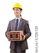 Купить «Строитель держит кирпич», фото № 3720120, снято 22 мая 2012 г. (c) Elnur / Фотобанк Лори