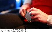 Купить «Руки девушки, сидящей на пассажирском кресле», видеоролик № 3730048, снято 31 января 2011 г. (c) Losevsky Pavel / Фотобанк Лори