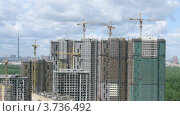 Купить «Башенные краны на стройке жилого комплекса, таймлапс», видеоролик № 3736492, снято 1 июня 2011 г. (c) Losevsky Pavel / Фотобанк Лори