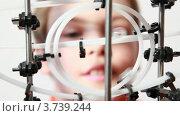 Купить «Мальчик смотрит на головоломку-лабиринт», видеоролик № 3739244, снято 8 июня 2011 г. (c) Losevsky Pavel / Фотобанк Лори