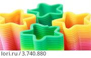 Купить «Пластиковые разноцветные игрушки-спирали в форме звезды  на белом фоне», видеоролик № 3740880, снято 5 мая 2011 г. (c) Losevsky Pavel / Фотобанк Лори