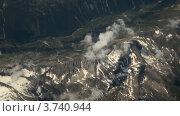 Купить «Вид на горы из иллюминатора самолета», видеоролик № 3740944, снято 16 мая 2006 г. (c) Losevsky Pavel / Фотобанк Лори