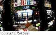 Купить «Мужчина сидит за слот-машиной в казино и нажимает на кнопки», видеоролик № 3754692, снято 5 сентября 2011 г. (c) Losevsky Pavel / Фотобанк Лори