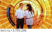 Купить «Пара стоит держась за руки в сказочно украшенном туннеле», видеоролик № 3755296, снято 25 ноября 2011 г. (c) Losevsky Pavel / Фотобанк Лори