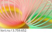 Купить «Цветная пластиковая игрушка вращается, на розовом фоне», видеоролик № 3759652, снято 15 октября 2011 г. (c) Losevsky Pavel / Фотобанк Лори
