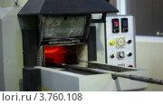Купить «Человек открывает печь для отжига», видеоролик № 3760108, снято 31 августа 2011 г. (c) Losevsky Pavel / Фотобанк Лори