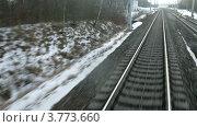 Купить «Поезд входит в тоннель и идет по железной дороге рядом с населенным пунктом, таймлапс», видеоролик № 3773660, снято 1 марта 2012 г. (c) Losevsky Pavel / Фотобанк Лори