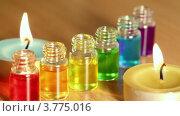 Купить «Бутылочки с цветным маслом в них и две свечки», видеоролик № 3775016, снято 22 февраля 2012 г. (c) Losevsky Pavel / Фотобанк Лори