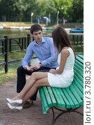 Купить «Двое молодых людей беседуют на лавочке», фото № 3780320, снято 15 июля 2012 г. (c) Михаил Иванов / Фотобанк Лори