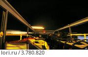 Купить «Пассажиры открытого автобуса едут по городу поздним вечером, таймлапс», видеоролик № 3780820, снято 19 апреля 2012 г. (c) Losevsky Pavel / Фотобанк Лори