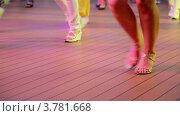Купить «Женщина делает шаги во время танца в латиноамериканском стиле», видеоролик № 3781668, снято 19 июня 2012 г. (c) Losevsky Pavel / Фотобанк Лори