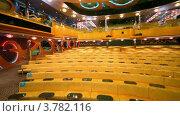 Купить «Пустой театр с рядами желтых диванов, круговое движение», видеоролик № 3782116, снято 1 июля 2012 г. (c) Losevsky Pavel / Фотобанк Лори