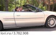 Купить «Молодой человек и девушка сидят на переднем сидении в кабриолете и улыбаются летним днем», видеоролик № 3782908, снято 25 апреля 2012 г. (c) Losevsky Pavel / Фотобанк Лори