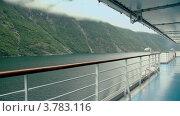 Купить «Пустая палуба корабля, плавающего на фиорде возле горы с лесом», видеоролик № 3783116, снято 16 мая 2012 г. (c) Losevsky Pavel / Фотобанк Лори