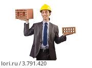 Купить «Строитель держит в руках пустотелый кирпич», фото № 3791420, снято 22 мая 2012 г. (c) Elnur / Фотобанк Лори