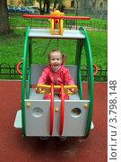 Купить «Радостная девочка играет на детской площадке», фото № 3798148, снято 28 августа 2012 г. (c) Николай Мухорин / Фотобанк Лори